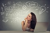 41678436-closeup-portrait-happy-young-woman-with-computer-thinking-dreaming-has-many-ideas-looking-up-isolate